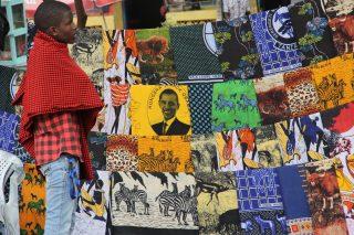 Tanzanian looking at colorful Kanga